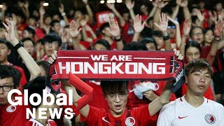 Hong Kong soccer fans hold anti-government protest at shopping district