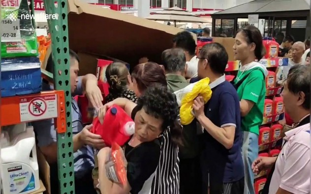 Customers climb under store shutter as China's first Costco shop opens