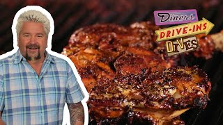 Guy Fieri Eats Jamaican Jerk Chicken | Diners, Drive-ins and Dives with Guy Fieri | Food Network