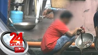 Vendor caught on video putting back food that fell on ground | 24 Oras